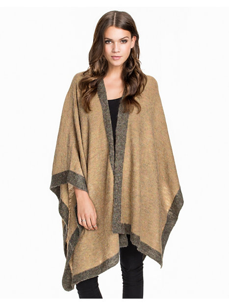 This cape came at the right time and it was a life saver - it is just want you need to finish an outfit,size color was perfect I wish it was reversable the tag in the inside can't be taken off without making a hole - ordering another color I'm a plus size and it was perfect - material is soft and I felt is was made well plenty of room to even wear a heavy sweater under for the price you can't.