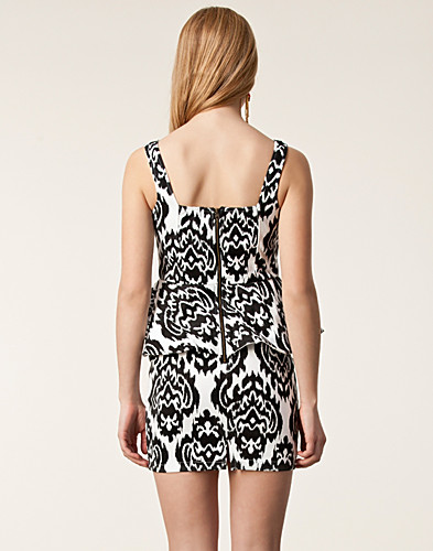 PARTY DRESSES - REVERSE / PRINT PEPLUM DRESS - NELLY.COM
