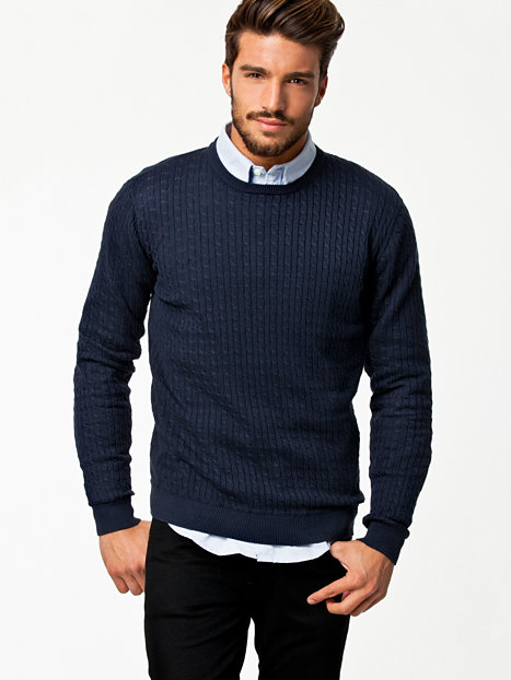 Sweater: In the UK this is the same as a jumper, a garment you wear over your shirt, with no buttons, and is pulled over your head. In the US this is a similar item, however, a cardigan with buttons can also be called a sweater in the US.